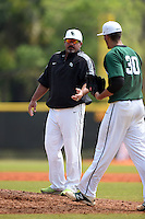 Farmingdale State Rams head coach Keith Osik takes the ball from pitcher Dalton McCarthy (30) during a game against the U-Mass Boston Beacons at North Charlotte Regional Park on March 19, 2015 in Port Charlotte, Florida.  U-Mass Boston defeated Farmingdale 9-5.  (Mike Janes/Four Seam Images)