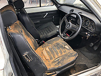 BNPS.co.uk (01202) 558833. <br /> Pic: Charterhouse/BNPS<br /> <br /> Pictured: The car has been stored for nearly 25 years. <br /> <br /> A clapped-out Ford Escort which has been languishing in a garage for nearly 25 years is tipped to sell for £25,000.<br /> <br /> The rare 1975 Mk 1 RS2000 model is in a rusty state and is in need of lots of care and attention.