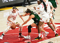 COLLEGE PARK, MD - DECEMBER 8: Stephanie Karcz #10 of Loyola and Faith Masonius #13 of Maryland go for a loose ball during a game between Loyola University and University of Maryland at Xfinity Center on December 8, 2019 in College Park, Maryland.