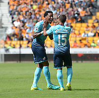 Pictured: Saturday 30 July 2016<br /> Re: Wolverhampton Wanderers v Swansea City FC, pre-season friendly at the Molineux Stadium, England, UK<br /> Swans Wayne Routledge celebrates his goal with Lerot Fer