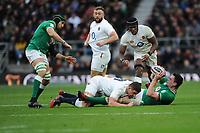James Ryan of Ireland looks for support after being tackled by Charlie Ewels as Maro Itoje of England looks on during the Guinness Six Nations match between England and Ireland at Twickenham Stadium on Sunday 23rd February 2020 (Photo by Rob Munro/Stewart Communications)