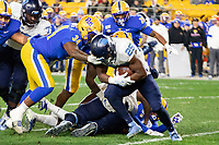 Pitt defensive lineman Amir Watts (34) tackles North Carolina running back Javonte Williams (25). The Pitt Panthers defeated the North Carolina Tarheels 34-27 in overtime in the football game on November 14, 2019 at Heinz Field, Pittsburgh, Pennsylvania.