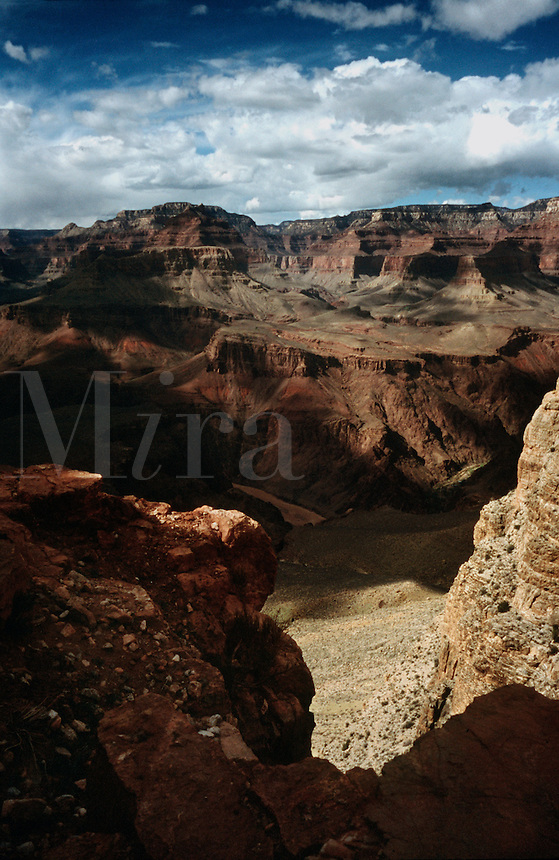 View of Grand Canyon toward Tonto Platform and North Rim, including horizon view of Brahma Temple and Zoraster Temple on the upper left ridge, along the South Kaibab Trail in Grand Canyon National Park, Arizona.