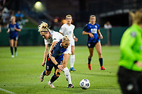 TACOMA, WA - JULY 31: Freja Olofsson #8 of Racing Louisville FC and Jessica Fishlock battles for the ball during a game between Racing Louisville FC and OL Reign at Cheney Stadium on July 31, 2021 in Tacoma, Washington.