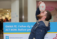 Pictured: Adam Griffiths tries to balance a rugby ball on the bridge of his nose Saturday 18 Saturday<br />