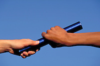 Hands pass baton in relay race. Relay racers.