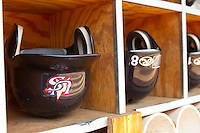 Team USA batting helmets in the dugout at Durham Bulls Athletic Park July 18, 2010, in Durham, North Carolina.  Photo by Brian Westerholt / Four Seam Images