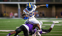 Torrance Moore (22) of North Little Rock gets tackled by Ryan Maxwell (15) of Fayetteville at Harmon Field , AR, on Friday,September 10, 2021 / Special to NWADG David Beach