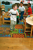 MR / Schenectady, NY.Yates Arts Magnet School / Pre-K.Students actively move to music in classroom. (boy in foreground, 4).MR: Gar4.PN#: 28895                           FC#: 20320-00505.scan from slide.©Ellen B. Senisi