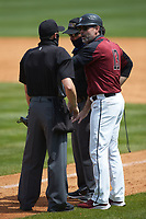 North Carolina Central Eagles head coach Jim Koerner (13_ argues a call with home plate umpire Jerry Buresh (left) and third base umpire Mike Mackey during the game against the North Carolina A&T Aggies at Durham Athletic Park on April 10, 2021 in Durham, North Carolina. (Brian Westerholt/Four Seam Images)
