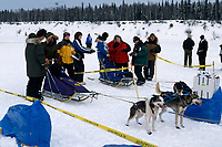 Teams Check in Two at a Time at Yentna Checkpoint<br /> 2004 Iditarod