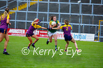 Kerry's Emma Dineen heads into attacking mode despite the attention from Wexford's Ciara O'Reardon and Kellie Kearney in the Lidl LGFA National football league game in Fitzgerald Stadium Killarney on Sunday.
