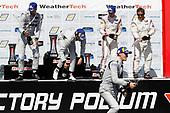 #77 Mazda Team Joest Mazda DPi, DPi: Oliver Jarvis, Tristan Nunez, #55 Mazda Team Joest Mazda DPi, DPi: Jonathan Bomarito, Harry Tincknell, #6 Acura Team Penske Acura DPi, DPi: Juan Pablo Montoya, Dane Cameron, podium, champagne
