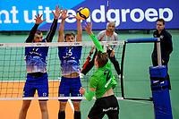 GRONINGEN - Volleybal, Lycurgus - SSS , Eredivisie, Martiniplaza, seizoen 2021-2022,  03-10-2021,  SSS speler Alex Meijs slaat de bal in het blok van Lycurgus speler Niels de Vries en Lycurgus speler Bjarne Huus