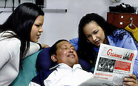 n this photo released Friday, Feb. 15, 2013 by Miraflores Presidential Press Office, Venezuela's President Hugo Chavez, center, poses for a photo with his daughters, Maria Gabriela, left, and Rosa Virginia at an unknown location in Havana, Cuba, Thursday, Feb. 14, 2013