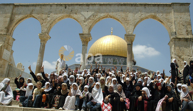 A Palestinian girls shout slogans to Al-Aqsa mosque during a summer camp organized by the Islamic movement in the old city of Jerusalem on July 8, 2009. Photo by Mahfuz Abu Turk