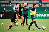 TACOMA, WA - JULY 31: Dzsenifer Marozsan #8 of the OL Reign looks for a pass before a game between Racing Louisville FC and OL Reign at Cheney Stadium on July 31, 2021 in Tacoma, Washington.