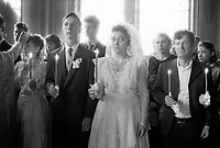Russia. Krasnodar Krai Region. Krasnodar. Orthodox church. Wedding ceremony. The bride and groom, with family relatives, all holding candles. Krasnodar (also known as Kuban) is the largest city and the administrative centre of Krasnodar Krai in Southern Russia. 26.09.1993 © 1993 Didier Ruef