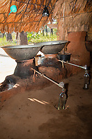Myanmar, Burma, near Bagan.  Distilling Alcohol from the Juice of the Toddy Palm (Sugar Palm).