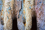 Top of old heating radiator in salvage yard coated with age, paint, and dirt.