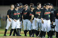 Nate Nolan (18) of the Great Falls Voyagers is congratulated by his teammates following his walk-off walk against the Helena Brewers at Centene Stadium on August 19, 2017 in Helena, Montana.  The Voyagers defeated the Brewers 8-7.  (Brian Westerholt/Four Seam Images)