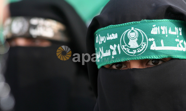 Palestinian women, supporters of Hamas Islamist movement, attend a protest in Gaza City against what the Islamists say is the arrest of hundreds of its members by Palestinian authorities in the West Bank. Hamas said last week that the Palestinian Authority is holding more than 600 of its members, adding that it was willing to hold reconciliation talks with Palestinian president Mahmud Abbas.
