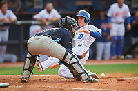 St. Lucie Mets designated hitter Ian Strom (10) slides into home plate as catcher David Rodriguez (13) tries to field the throw during the first game of a doubleheader against the Charlotte Stone Crabs on April 24, 2018 at First Data Field in Port St. Lucie, Florida.  St. Lucie defeated Charlotte 5-3.  (Mike Janes/Four Seam Images)
