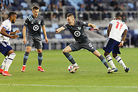 SAINT PAUL, MN - MAY 12: Jan Gregus #8 of Minnesota United FC moves past Cristian Dajome #11 of Vancouver Whitecaps FC during a game between Vancouver Whitecaps and Minnesota United FC at Allianz Field on May 12, 2021 in Saint Paul, Minnesota.