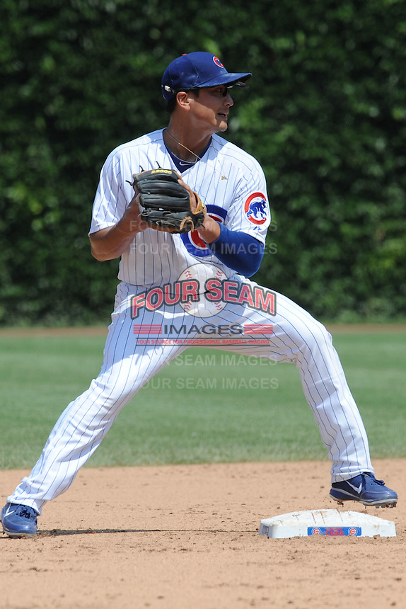 Chicago Cubs second baseman Darwin Barney #15  fields the ball and throws to first during a game against the Arizona Diamondbacks at Wrigley Field on July 15, 2012 in Chicago, Illinois. The Cubs defeated the Diamondbacks 3-1. (Tony Farlow/Four Seam Images).