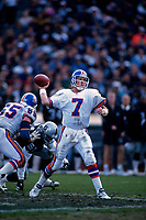 OAKLAND, CA:  Quarterback John Elway of the Denver Broncos in action against the Oakland Raiders during a game at the Oakland Coliseum in Oakland, California in 1995. (Photo by Brad Mangin)