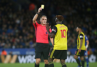 Referee Graham Scott shows a yellow card to Watford's Isaac Success <br /> <br /> Photographer Stephen White/CameraSport<br /> <br /> The Premier League - Leicester City v Watford - Saturday 1st December 2018 - King Power Stadium - Leicester<br /> <br /> World Copyright © 2018 CameraSport. All rights reserved. 43 Linden Ave. Countesthorpe. Leicester. England. LE8 5PG - Tel: +44 (0) 116 277 4147 - admin@camerasport.com - www.camerasport.com