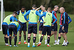 Mark Warburton briefs the yellow team after an exhaustive stint at training