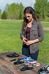 Young woman preparing for some target shooting.