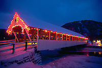 Covered bridge at Christmastime decorated with Christmas lights. Stark, New Hampshire.