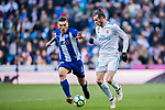 Gareth Bale (R) of Real Madrid battles for the ball with Daniel Alejandro Torres Rojas, D Torres, of Deportivo Alaves during the La Liga 2017-18 match between Real Madrid and Deportivo Alaves at Santiago Bernabeu Stadium on February 24 2018 in Madrid, Spain. Photo by Diego Souto / Power Sport Images