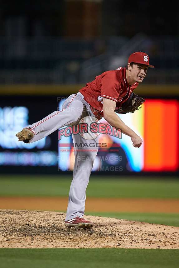 North Carolina State Wolfpack relief pitcher Tommy DeJuneas (42) follows through on his delivery against the Charlotte 49ers at BB&T Ballpark on March 29, 2016 in Charlotte, North Carolina. The Wolfpack defeated the 49ers 7-1.  (Brian Westerholt/Four Seam Images)