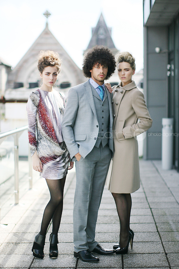 14/7/2010. Brown Thomas Autumn winter 2010. Pictured in Brown Thomas offices Dublin to launch the Brown Thomas Autumn winter 2010 collection are Models Carl wears an Etro suit EUR1190, Sarah wears a Prada coat EUR2400 and Nasrin wears a Peter Pilotto print dress EUR1070 with Nicholas Kirkwood shoes Picture James Horan/Collins