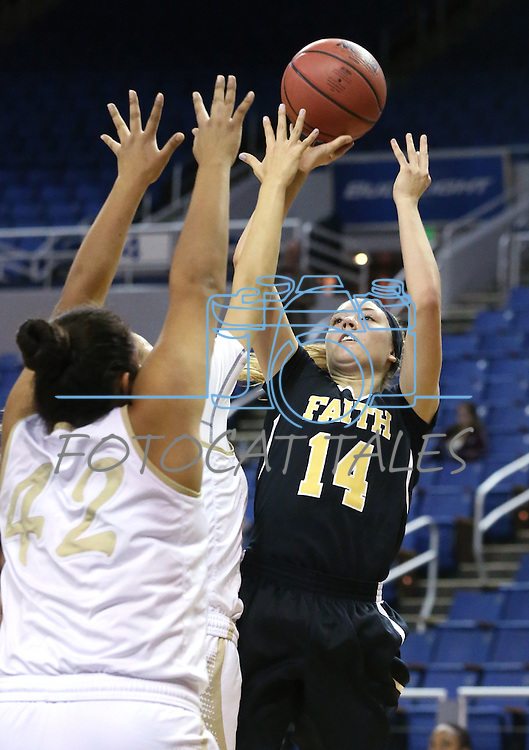 Faith Lutheran's Sam Caruth shoots over Spring Valley defenders Myra Tadytin and Essence Booker during the NIAA Division I-A state basketball championship in Reno, Nev. on Saturday, Feb. 27, 2016. Faith Lutheran won 50-47. Cathleen Allison/Las Vegas Review-Journal