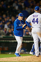 Chicago Cubs manager Joe Maddon (70) walks to the mound for a pitching change in the seventh inning during Game 4 of the Major League Baseball World Series against the Cleveland Indians on October 29, 2016 at Wrigley Field in Chicago, Illinois.  (Mike Janes/Four Seam Images)