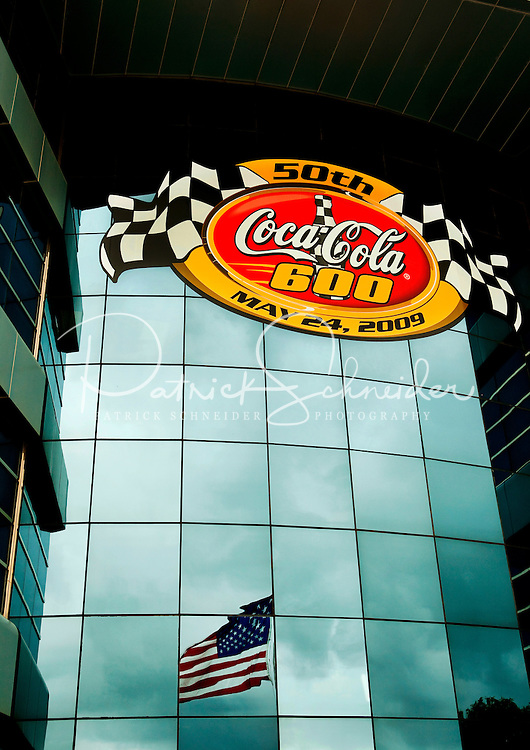 Scenes from the Coca-Cola Classic 900 NASCAR Race at the Lowe's Motor Speedway, in Concord, NC, held on Memorial Day 2009 (the race was delayed a day because of rain). Driver David Reutimann won his first Cup race during the rain-shortened event, held May 25, 2009. NASCAR's longest scheduled race went only 227 laps, or 340.5 miles, before officials ended it because of rain. The 2009 race was the 50th running of the Coca-Cola 600. Ryan Newman and Robby Gordon finished second and third respectively.