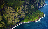 An aerial view of a waterfall along the Hamakua coastline north of Waipi'o Valley, Big Island.