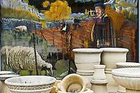Europe/Europe/France/Midi-Pyrénées/46/Lot/Cajarc: Etalage de poteries en pierre factice  d'un Supermarché et vitrine  kiotsch peinte représentant un berger et ses moutons sur le Causse du Quercy