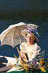 A Victorian woman in a row boat reading