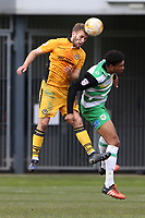 Mickey Demetriou of Newport County and Omar Sowunmi of Yeovil Town contend for the aerial ball during the Sky Bet League Two match between Newport County and Yeovil Town at Rodney Parade, Newport, Wales, UK. 14 April 2017