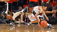 Feb. 3, 2011; Charlottesville, VA, USA; Wake Forest Demon Deacons guard Brooke Thomas (1) and Virginia Cavaliers guard China Crosby (1) go after the loose ball during the game at the John Paul Jones Arena.  Mandatory Credit: Andrew Shurtleff