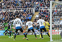 Bafetibis Gomis of Swansea City (left) puts his header over the bar of the goal during the Barclays Premier League match between Newcastle United and Swansea City played at St. James' Park, Newcastle upon Tyne, on the 16th April 2016