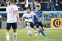 SAN JOSE, CA - AUGUST 13: Brian White #24 of the Vancouver Whitecaps battles Nathan Cardoso #13 of the San Jose Earthquakes during a game between San Jose Earthquakes and Vancouver Whitecaps at PayPal Park on August 13, 2021 in San Jose, California.