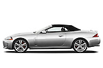 Driver side profile view of a 2011 Jaguar XKR Convertible .