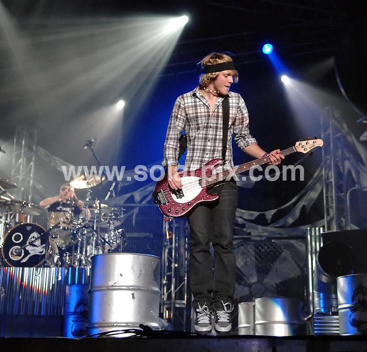 **ALL ROUND PICTURES FROM SOLARPIX.COM**.**WORLDWIDE SYNDICATION RIGHTS**.McFly perform live in concert at the Liverpool Echo Arena, Liverpool, UK. 29th November 2008..This pic: Dougie Poynter from McFly..JOB REF: 8041 SGD     DATE: 29_11_2008.**MUST CREDIT SOLARPIX.COM OR DOUBLE FEE WILL BE CHARGED* *UNDER NO CIRCUMSTANCES IS THIS IMAGE TO BE REPRODUCED FOR ANY ONLINE EDITION WITHOUT PRIOR PERMISSION*
