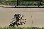 Woman riding her bike on a sidewalk in Denver, Colorado. .  John offers private photo tours in Denver, Boulder and throughout Colorado. Year-round.